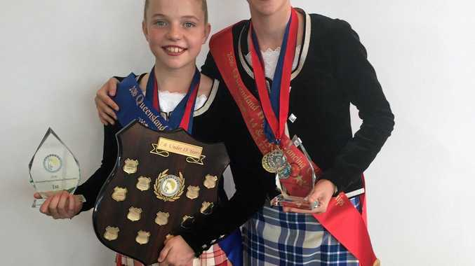 Tully Stone and Hannah Hughes with their prizes from Mackay.