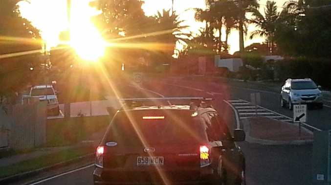 CONCERNING: Sun strike at site of proposed new bus stop on Main Road, Maroochydore, near Radiata Drive. The new bus stop will be just past the 60km/h speed limit sign, just visible beyond the roof racks of the black vehicle in this photograph.