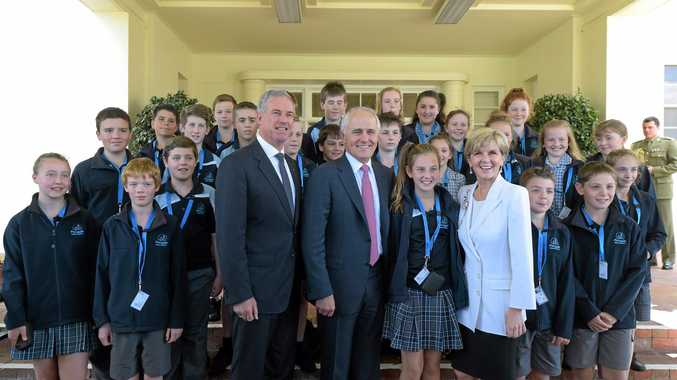 VISIT: Australian Prime Minister Malcolm Turnbull, Australian Foreign Minister Julie Bishop (right) and Australian Minister for Tourism Richard Colbeck (left) pose with Tasmanian schoolkids. Sen Colbeck will visit the Coast tonight.