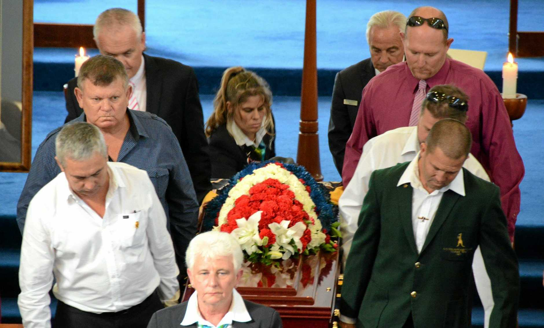 A guard of honour carries Tweed rugby league legend Ron Saddler's coffin from Murwillumbah's All Saints Anglican Church on Tuesday.