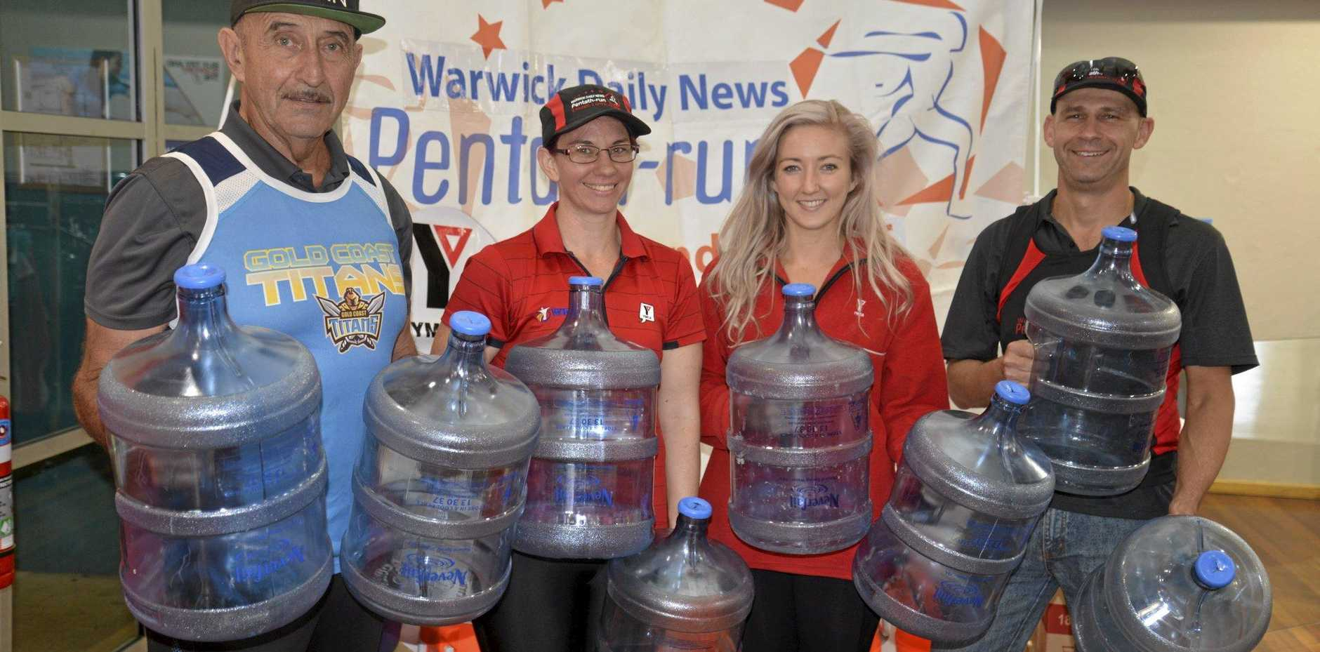 Daily News Pentath-run logistics co-ordinator Jonno Felton, WIRAC/YMCA staff Carla Thornton and Cassie Taylor and Pentath-run event director Neil Burtenshaw will be stocking up on water for a hot weekend of racing.