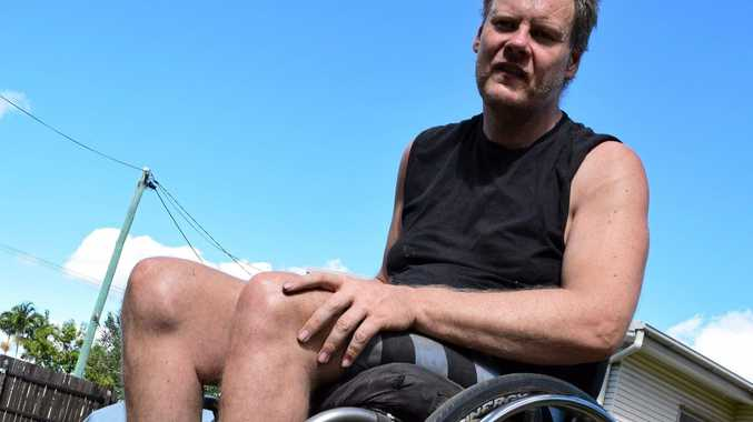 STRONGER: David Warry lost 40kg to fit into his new wheelchair. INSET: David, pictured before he lost the weight, uses his special exercise bike.