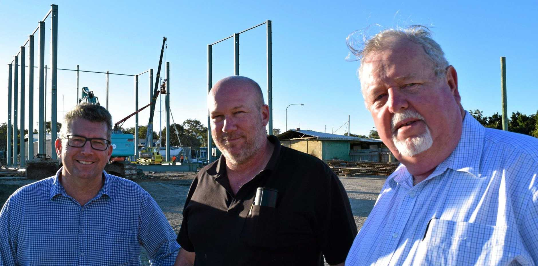 BUILDING CONFIDENCE: Federal member for Hinkler Keith Pitt (L), business owner Steve Murphy and Senator Barry O'Sullivan at the travel lift construction site in Urangan.