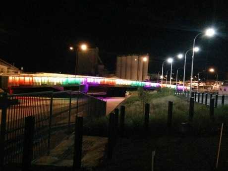 The prominent landmark is lit up in rainbow colours. Photo Lance Horder