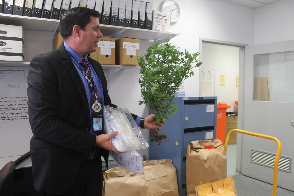 Detective Acting Inspector Jeremy Novosel, Inspector for Crime and Support Services holding some of drugs seized by police as part of Operation North Slingshot.