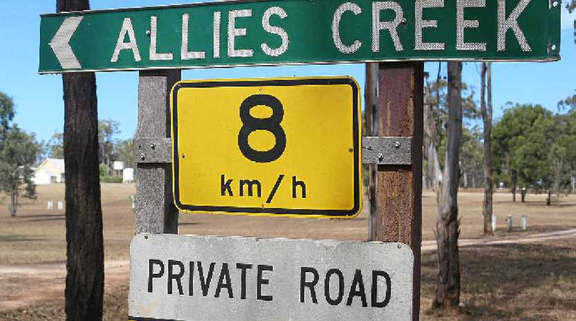 SOLD: Signs pointing to Allies Creek, which is under contract to a new owner.