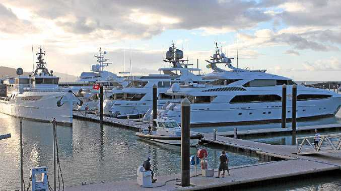 Superyachts arriving in Abell Point Marina.