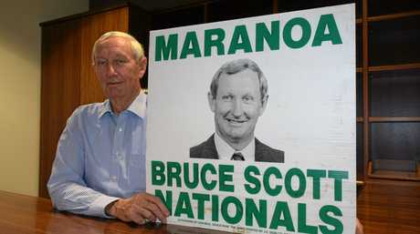 Maranoa MP Bruce Scott holds up a sign from his first election campaign in 1990.