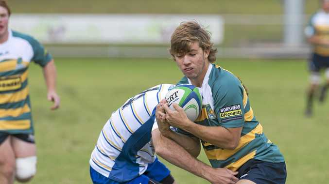 Darling Downs Colts player Cameron Griffin is tackled by a Gold Coast player in under 19 South Queensland Championships rugby union at Gold Park, Sunday, May 17, 2015. Photo Kevin Farmer / The Chronicle