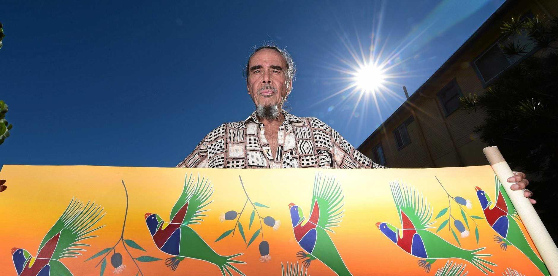 OLD WAYS: Tweed Coast Aboriginal elder Uncle Magpie displays  his art .