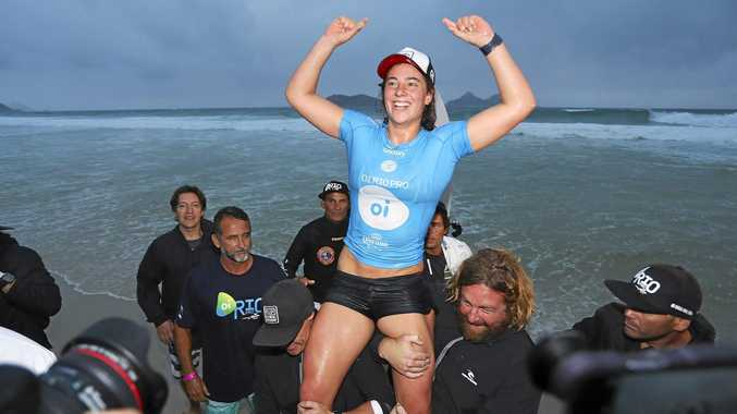 Former Lennox Head surfer Tyler Wright is chaired up the beach after winning the Rio Pro.
