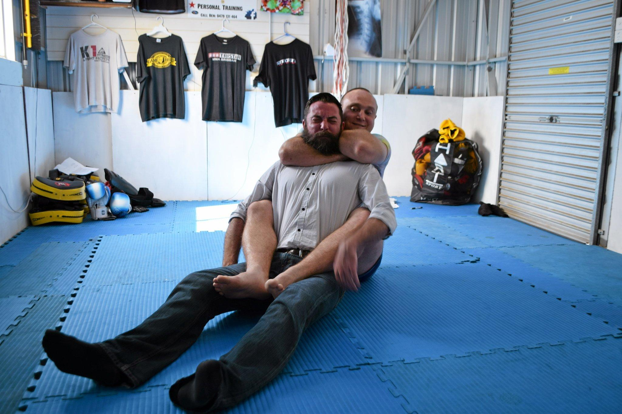 TAP OUT: Reporter Jonno Colfs get the chokehold from MMA trainer Ben Pepper.