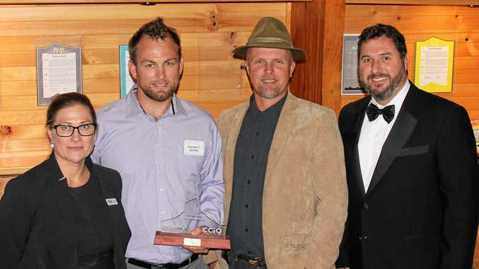 JOB WELL DONE: Representatives of gold award winner Concept IT Maleny, with Member for Glass House Andrew Powell (right).