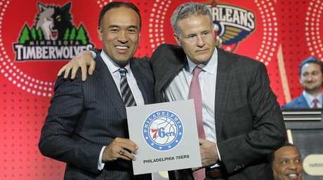 NBA deputy commissioner Mark Tatum, left, poses for a photo with Philadelphia 76ers head coach Brett Brown.