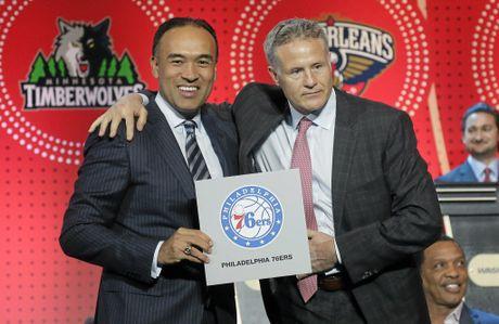 NBA deputy commissioner Mark Tatum, left, poses for a photo with Philadelphia 76ers head coach Brett Brown.
