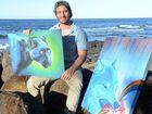 ART FINALIST: Jeremy Kiraly with his creative artwork at Burnett Heads. Photo: Paul Donaldson / NewsMail