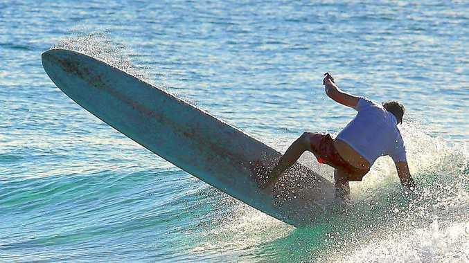 Small wave, big pivot. PHOTO: SLIDEAHOLICS.COM