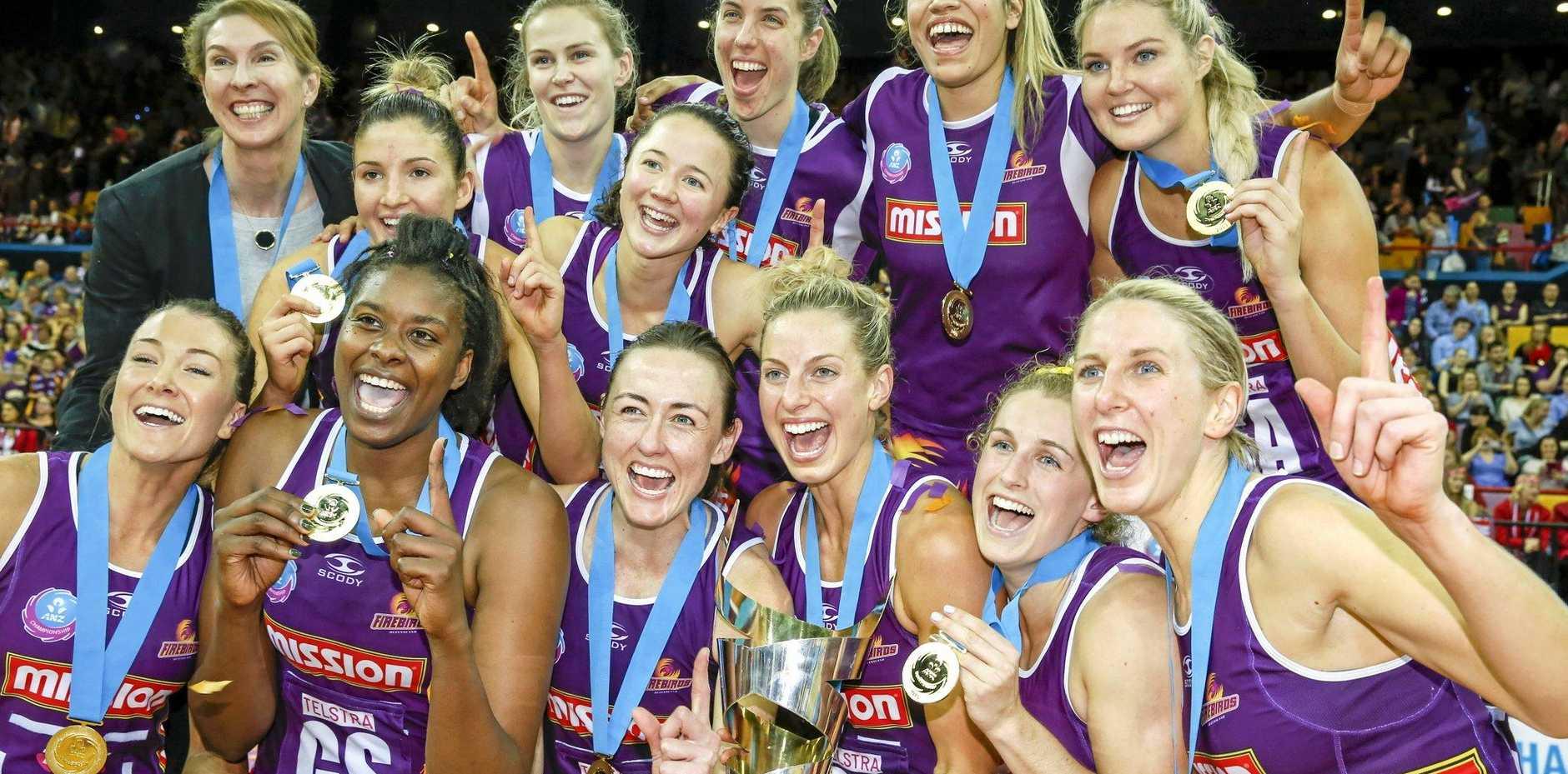 Queensland Firebirds players celebrate winning last season's ANZ Championship grand final.