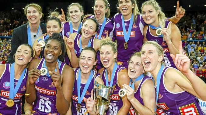 Queensland Firebirds players celebrate winning last season's ANZ Championship grand final.