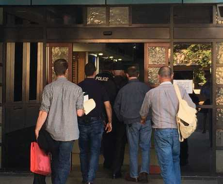 A former Darling Downs police officer arrested outside court following QCAT hearing in Toowoomba.