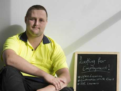 Job seeker Jye McKewin has made a sign to show passing motorists in an effort to gain employment.