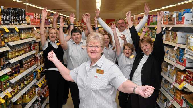 HALF A CENTUARY: Coles staff member June Groves (front) celebrates a 50-year-long career with Coles supermarkets.