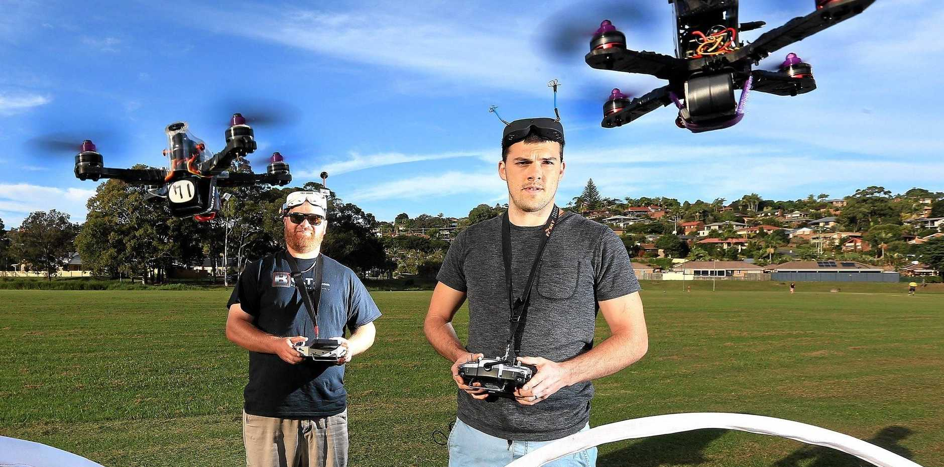 BOYS WITH TOYS: Tweed Coast champion drone racers, Ross Kerker and Jerome Partland get some practice in at Banora Point.
