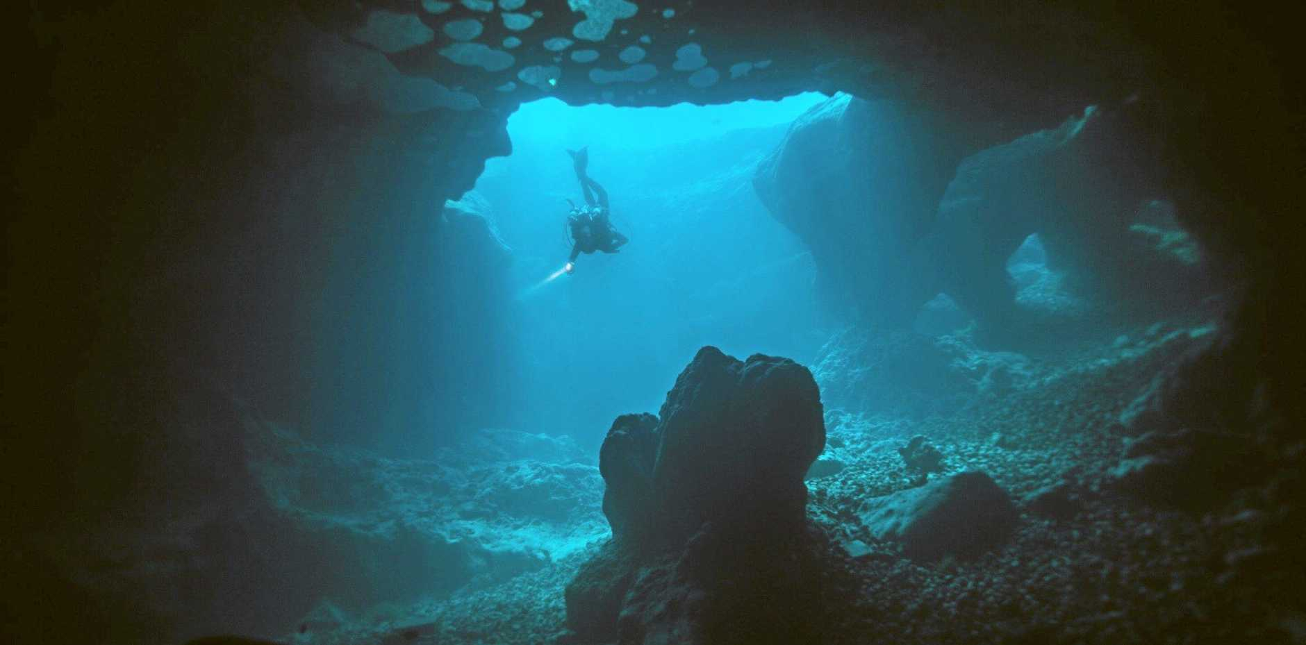 Cave diving.