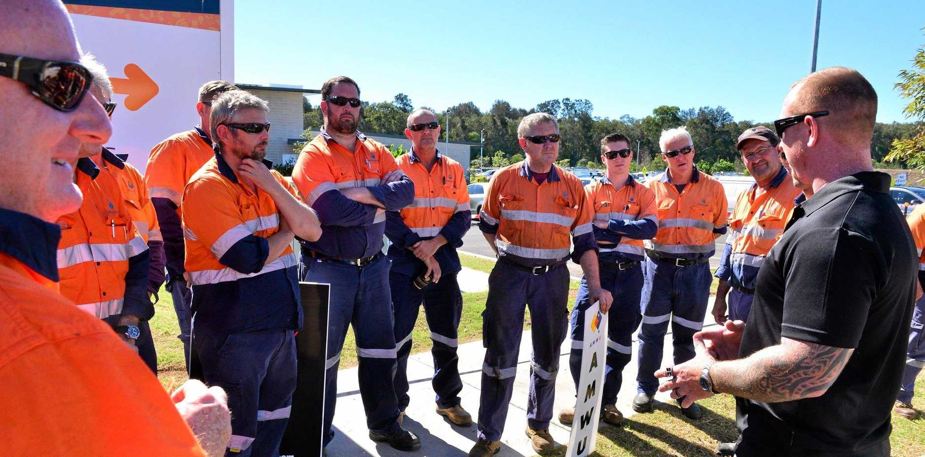Dan Bessell with Unity Water workers who have walked off the job.  Photo: John McCutcheon / Sunshine Coast Daily