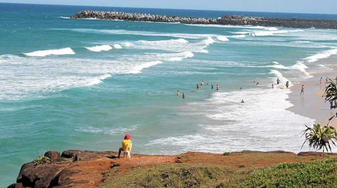 ON WATCH: A Ballina Lighthouse-Lismore Surf Life Saving Club members keeps watch over a swimmers at Lighthouse Beach on the Sunday of the October long weekend.  Photo Graham Broadhead / Ballina Shire Advocate