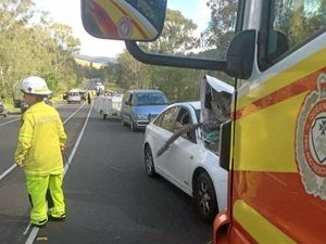 Multi vehicle crash, fallen powerlines close Bruce Hwy