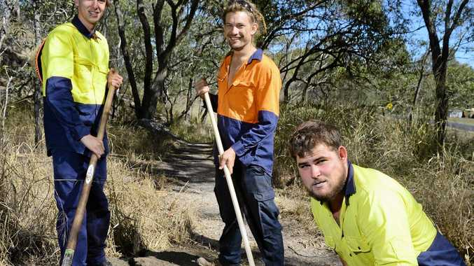 DRAWCARD: Skills Alliance project supervisor Jared Wolff (centre) and trainees Jazz Mejias (left) and Luke Clarke carry out work on the trails at Blackstone Hill.