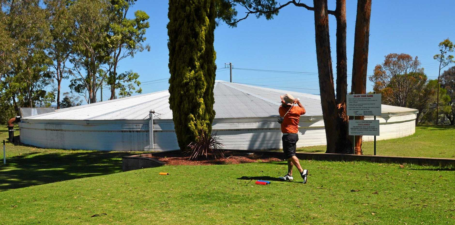 Shane McKenzie tees off in one of his rounds at Warwick Golf Club.