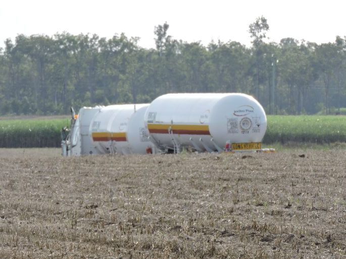 Police have placed an 800m exclusion zone around a truck leaking a potentially dangerous substance on the Bruce Highway near Maryborough.
