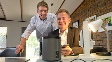 EASY APPS: Withcott resident Edward Greer (left) and Telstra area general manager Darren Clark and look at new apps available to make life easier in the home.