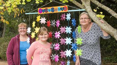 ON A MISSION: Toowoomba residents (from left) Jodie and Tanika, 10, Lingard and Sue Vaughan with friends strive to make 10,000 handmade stars.