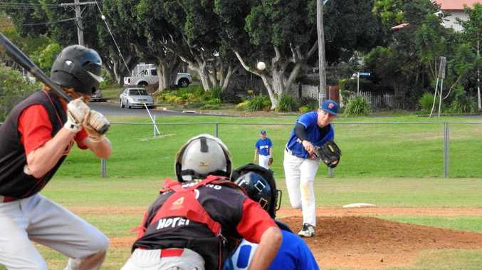 RIGHT: Norths' James Clark awaits a pitch from Workers' Jordan Williams, collecting one of his three hits.