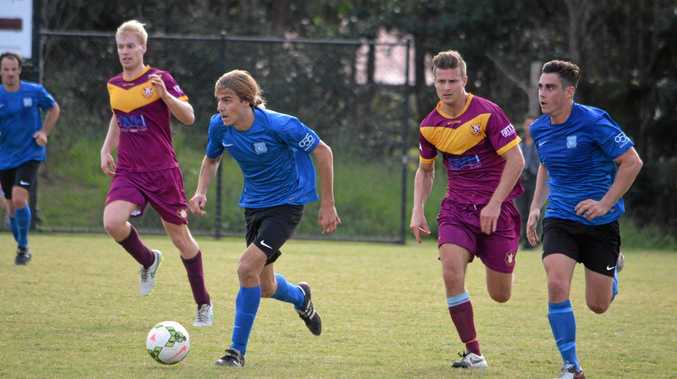 ON THE MOVE: Bangalow's Josh Cole and Scott Fuller get the Bluedogs' attack moving against Urunga in the FFA Cup game at Bangalow on Saturday.