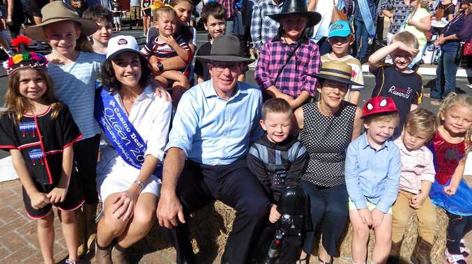 Newly crowned Beef Week Queen Georgie King with the Governor of NSW David Hurley, his wife Linda Hurley and local Evans Heads children.