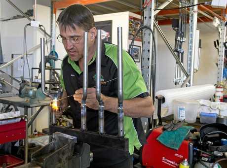 DRIVEN: Scott Errington in his workshop.