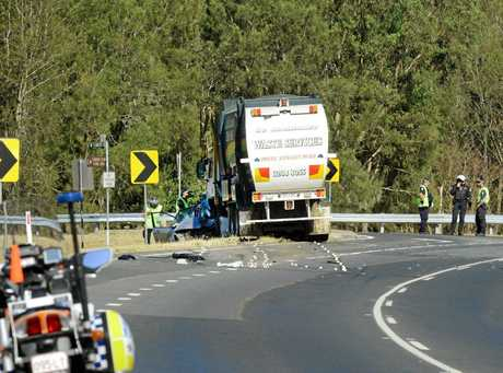 Forensic Police officers at the scene of a double fatality on the Ipswich Boonah Road at Peak Crossing.