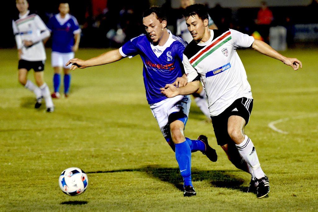 Sunbury's Lyndon Linwood and United Park Eagle Brendan Davis battle for the ball. Photo: Valerie Horton / Fraser Coast Chronicle