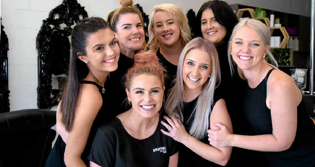 TOGETHER: Intuition: The Art of Hair staff Kayla Vella (back left), Larissa Anderson, Brittany Miller, Kate Turvey, and Victoria Edwards (front left), owner Sammy Hayes and Meryn Dunn, couldn't be happier with their workplace.