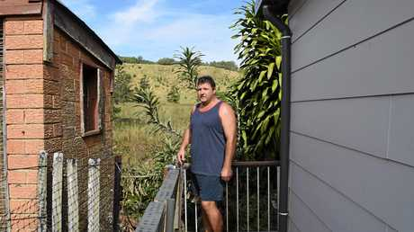 Resident Barry Pappin at the rear of his yard where he has collected sands to be lab tested.