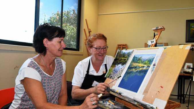 IN THE PASTELS: Debbie Bond (left) works on her piece while Karol Oakley supervises at the Maranoa Artists Pastel Workshop.