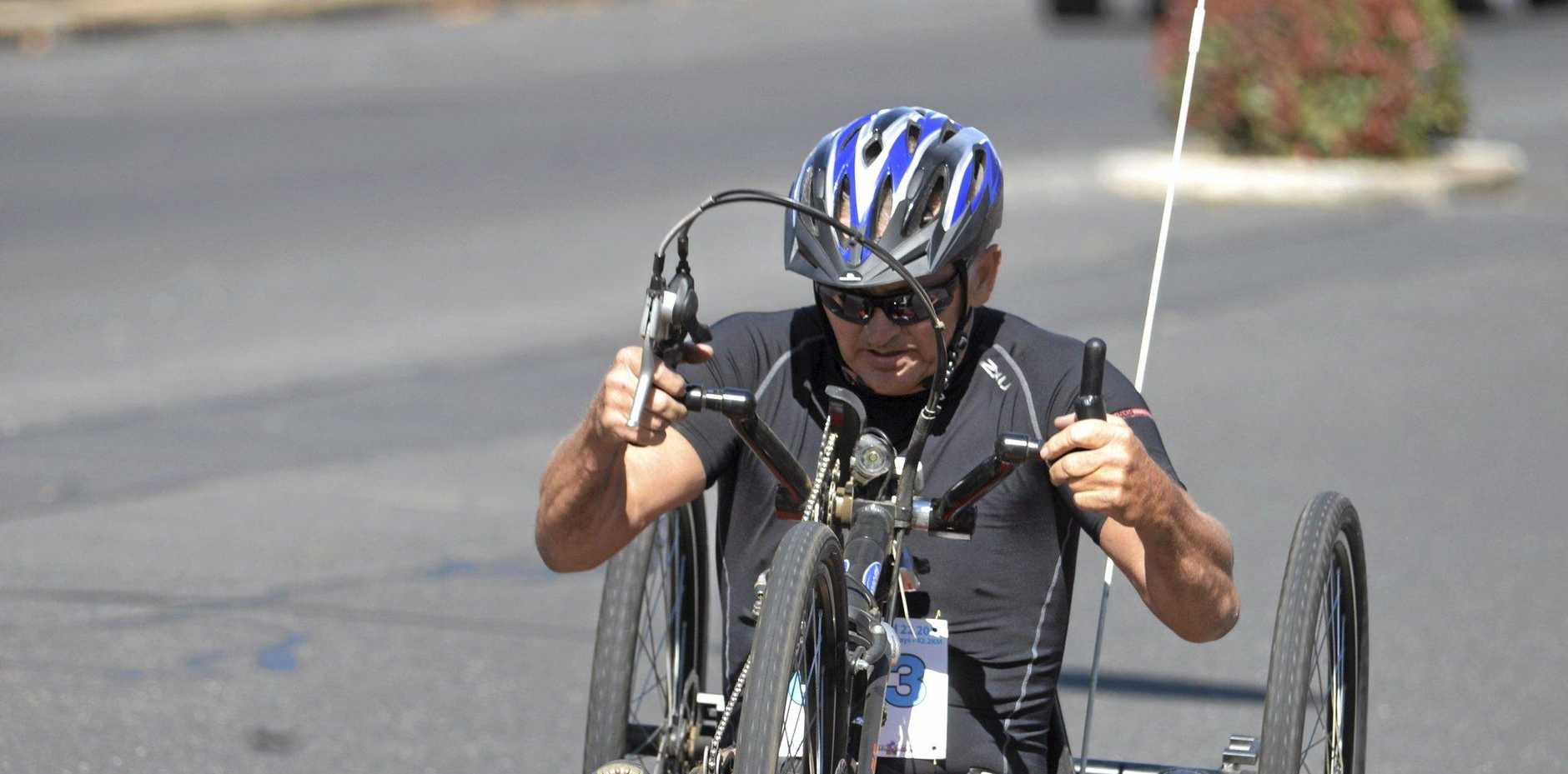 FAST: Warwick competitor Peter McDonnell wins a wheelchair race in Daily News Pentath-run.