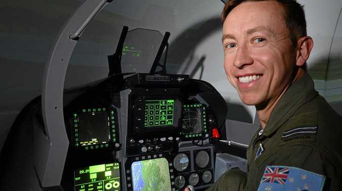Air Force flight Lieutenant Andrew Robinson at Caloundra with an Air Force simulator.