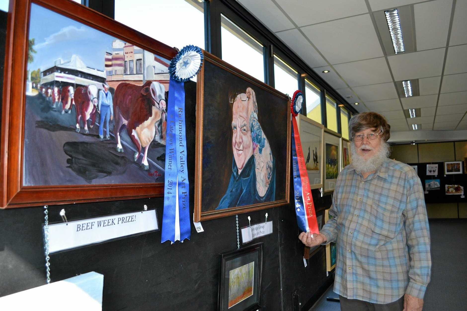 DOUBLE WIN: Ralph Smith with his two works of art that took out the top prizes in the Beef Week Art and Photography Competition in 2014.
