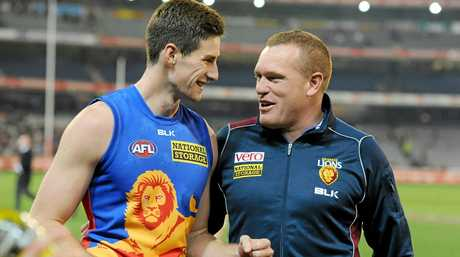 Jonathan Freeman celebrates with Brisbane coach Justin Leppitsch, after the side's win in the Round 21 AFL match between the Collingwood Magpies and the Brisbane Lions at the MCG in Melbourne, Saturday, 16 Aug. 2014. (AAP Image/Joe Castro) NO ARCHIVING, EDITORIAL USE ONLY