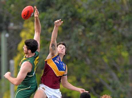 AFL: Maroochydore v Moreton Bay. Fisherman's Road Sport Complex. May 21, 2016. Maroochydore player number 15 (green and gold) Jacob Simpson goes high for the ball.